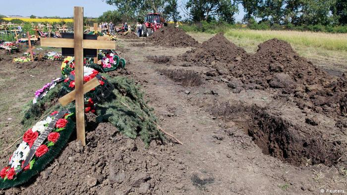 Graves, dug for flood victims, are seen at the central cemetery in Krymsk in the Krasnodar region, southern Russia, July 9, 2012. Russia began a day of mourning on Monday for the 171 people killed in floods that drove thousands from their homes, with the causes of the disaster posing hard questions for the authorities, including President Vladimir Putin. REUTERS/Eduard Korniyenko (RUSSIA - Tags: DISASTER ENVIRONMENT POLITICS OBITUARY)