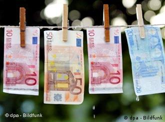 Euro notes hanging from a clothes line