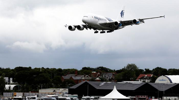 An Airbus A380 lands after performing a display flight at the Farnborough Airshow 2012 in southern England July 9, 2012. (Photo REUTERS/Luke MacGregor)