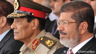 Hussein Tantawi with Mohammed Morsi