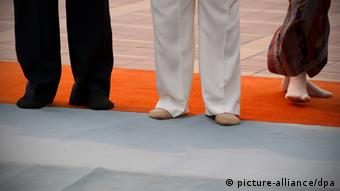 Chancellr Angela Merkel in the middle in socks