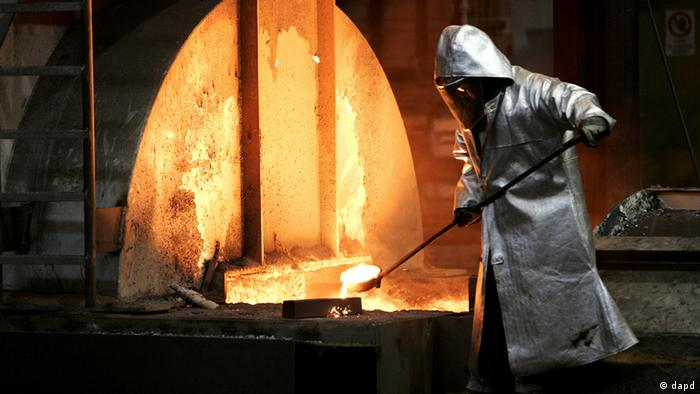 An employee working at a steel furnace (Photo via dapd)