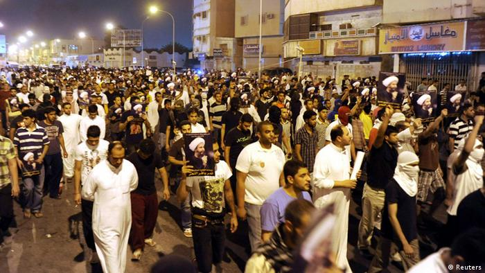 Protesters hold pictures of Sheikh Nimr al-Nimr during a rally at the coastal town of Qatif, against Sheikh Nimr's arrest July 8, 2012. Sheikh Nimr, a prominent Shi'ite Muslim cleric who was wanted by the police, was detained in Saudi Arabia's Eastern Province on Sunday over calls for more rights for the minority Muslim sect in the Sunni monarchy, his brother and an activist said. REUTERS/Stringer (SAUDI ARABIA - Tags: CIVIL UNREST RELIGION POLITICS)