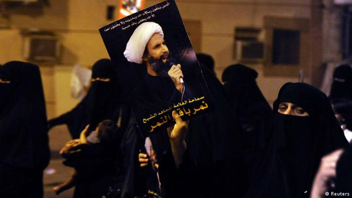 Source News Feed: EMEA Picture Service ,Germany Picture Service A protester holds up a picture of Sheikh Nimr al-Nimr during a rally at the coastal town of Qatif, against Sheikh Nimr's arrest July 8, 2012. Sheikh Nimr, a prominent Shi'ite Muslim cleric who was wanted by the police, was detained in Saudi Arabia's Eastern Province on Sunday over calls for more rights for the minority Muslim sect in the Sunni monarchy, his brother and an activist said. REUTERS/Stringer (SAUDI ARABIA - Tags: CIVIL UNREST RELIGION POLITICS)