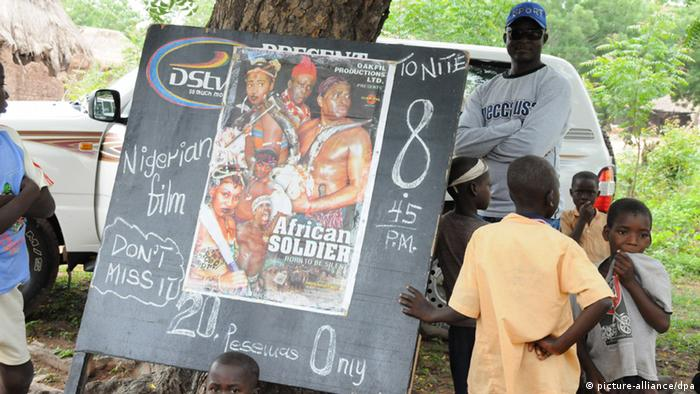 A blackboard advertises a Nigerian film called African soldier