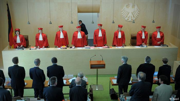 Judges in red robes, standing