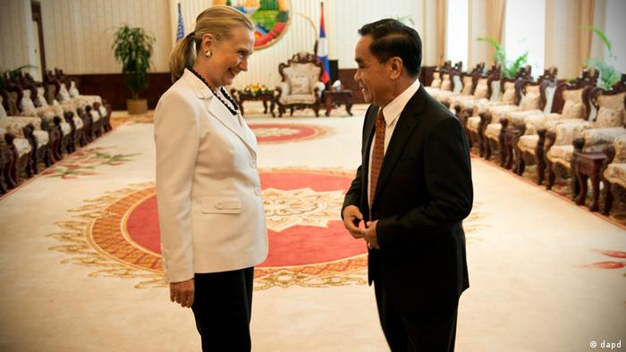U.S. Secretary of State Hillary Rodham Clinton and Laotian Prime Minister Thongsing Thammavong talk before a meeting at the Prime Minister's Office Affairs in Vientiane, Laos Wednesday, July 11, 2012. Clinton became the first U.S. secretary of state to visit Laos in more than five decades, gauging whether a place the United States pummeled with bombs during the Vietnam War could evolve into a new foothold of American influence in Asia. (AP Photo/Brendan Smialowski, Pool)