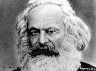 Black and white head shot of Karl Marx as an elderly man, with white hair and beard
