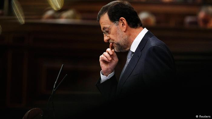 Spain's Prime Minister Mariano Rajoy gestures during a parliamentary session in Madrid, July 11, 2012. Rajoy said on Wednesday he would raise the value-added tax by 3 percentage points to 21 percent as part of a large package of tax hikes and spending cuts aimed at trimming the public budget by 65 billion euros over the next 2-1/2 years. With the economy in recession, unemployment high and tax income falling, Spain is struggling to meet tough deficit cutting targets that it has agreed on with the European Union. REUTERS/Andrea Comas (SPAIN - Tags: BUSINESS POLITICS TPX IMAGES OF THE DAY)
