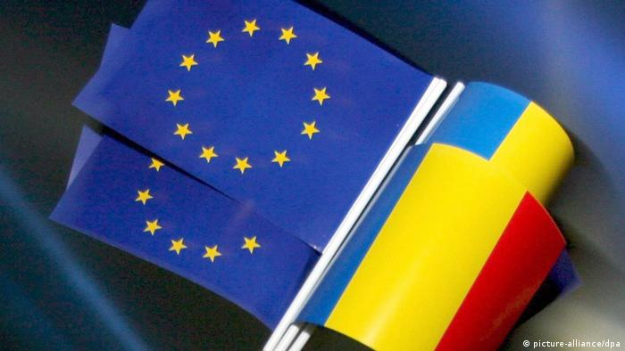 The EU and Romanian flags