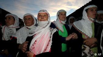 Bulgarian Muslims pay attention during a wedding ceremony in the Rhodope Mountain village of Ribnovo, some 230 kms. (143 miles) south from capital Sofia, Sunday, Nov. 19, 2006. The people of this mountain village are famous for performing their unique wedding ceremonies in winter time only. The inhabitants of the village of Ribnovo are Bulgarian-speaking Muslims, sometimes referred to as Pomaks or people who have suffered. Muslim Bulgarians are descendants of Christian Bulgarians who were ...