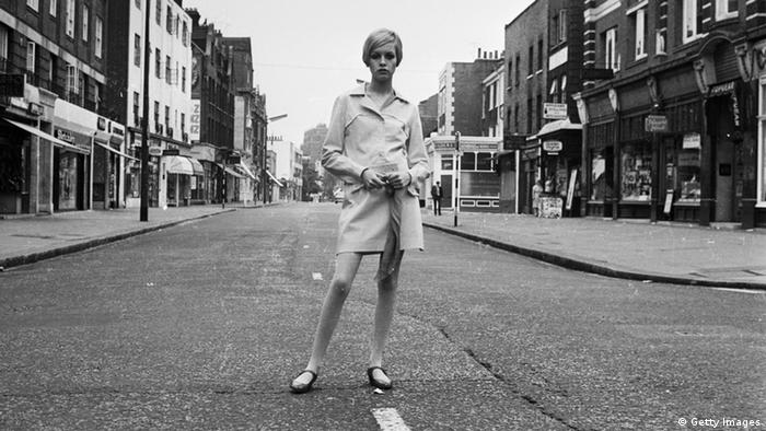 Twiggy in a short skirt and raincoat on King's Road in London
