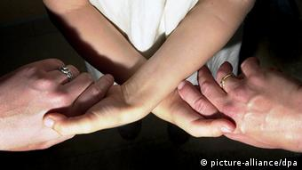 The hands of two Lesbian women and a child