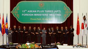 Foreign Ministers hold hands as they pose for a photograph during the 13th ASEAN Plus Three (APT) Foreign Minister's meeting at the office of the Council of Ministers in Phnom Penh July 10, 2012. (L-R) Myanmar's Foreign Minister Wunna Maung Lwin, Philippine's Foreign Minister Albert Rosario, Singapore's Foreign Minister K. Shanmugam, Thailand's Foreign Minister Surapong Tovichakchaikul, Vietnam's Deputy Foreign Minister Pham Quang Vinh, South Korea's Deputy Foreign Minister Kim Sung-Han, China's Foreign Minister Yang Jiechi, Cambodia's Foreign Minister Hor Namhong, Japan's Deputy Foreign Minister Tsuyoshi Yamaguchi, Brunei's Foreign Minister Prince Mohamed Bolkiah, Indonesia's director general for Association for Southeast Asian Nations (ASEAN) I Gusti Agung Wesaka Puja, Laos' Deputy Foreign Minister Alounkeo Kittikhoun, Malaysia's Foreign Minister Anifah Aman and ASEAN Secretary General Surin Pitsuwan. REUTERS/Samrang Pring (CAMBODIA - Tags: POLITICS)