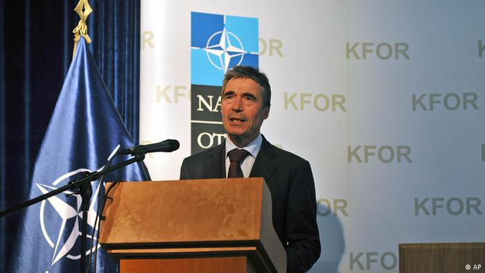 NATO Secretary General Anders Fogh Rasmussen speaks during a press conference in NATO military airport in Slatina, Kosovo, on Wednesday, July 11, 2012. ( AP Photo / Visar Kryeziu ).
