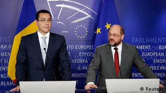 Romania's Prime Minister Victor Ponta and European Parliament President Martin Schulz (R) address a joint news conference after their meeting at the EU Parliament in Brussels July 11, 2012. Romania's prime minister assured European leaders on Wednesday that his government was fully committed to democracy and the rule of law after drawing fire for suspending President Traian Basescu by a vote in parliament. REUTERS/Francois Lenoir (BELGIUM - Tags: POLITICS)