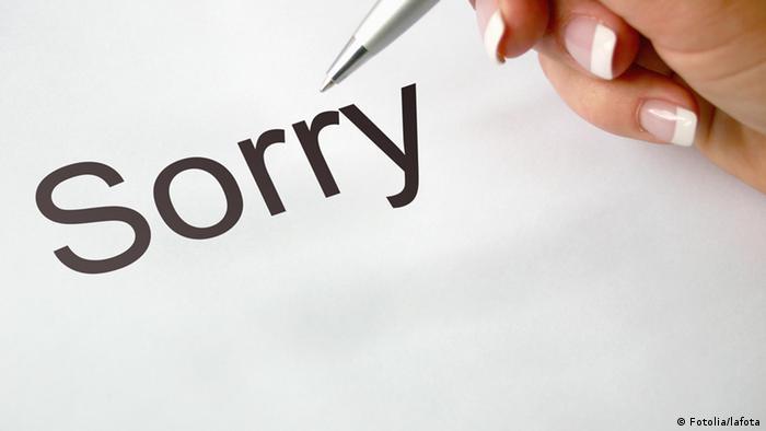 Рука женщины и надпись Sorry