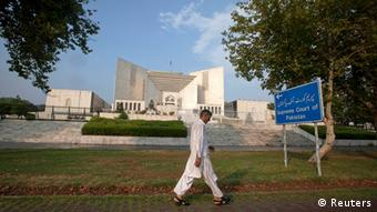 A man walks past the Supreme Court building in Islamabad on July 12, 2012 (Photo: REUTERS/Faisal Mahmood)