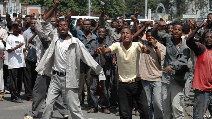 Ethiopian students demonstrate outside Addis Ababa Tegbareed Industrial College in the capital's Mexico area., Tuesday, June 7, 2005. Police raided a technical college in Ethiopia's capital Tuesday, beating up students and firing rubber bullets on the second day of defiance of a government ban on demonstrations, witnesses said. Clashes between police and student demonstrators on Monday left a girl dead, seven people injured and hundreds arrested in protests against disputed election results that left parliament in the hands of the ruling party. (AP Photo)