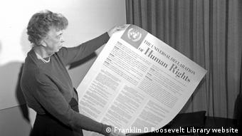 Eleanor Roosevelt holds a printed version of the Universal Declaration of Human Rights