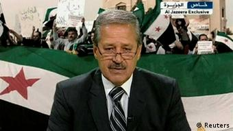 REFILE - ADDING RESTRICTION Syria's ambassador to Iraq Nawah al-Fares announces his resignation and decision to join the opposition forces against President Bashar al-Assad from an undisclosed location, in this still image taken from video footage July 11, 2012. Fares defected on July 11, 2012 in protest over Assad's violent suppression of a 16-month uprising as the U.N. Security Council remained deadlocked over the next steps in the crisis. MANDATORY CREDIT. REUTERS/Al-Jazeera via Reuters TV (POLITICS CIVIL UNREST CONFLICT) NO SALES. NO ARCHIVES. FOR EDITORIAL USE ONLY. NOT FOR SALE FOR MARKETING OR ADVERTISING CAMPAIGNS. THIS IMAGE HAS BEEN SUPPLIED BY A THIRD PARTY. IT IS DISTRIBUTED, EXACTLY AS RECEIVED BY REUTERS, AS A SERVICE TO CLIENTS. MANDATORY CREDIT. FONTS CANNOT BE OBSTRUCTED OR COVERED