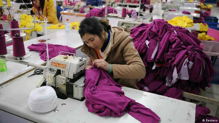Employees work at a garment factory in Wuhu, Anhui province in this February 1, 2012 file photo.
