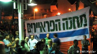 Activists holding a banner for an equal military draft law