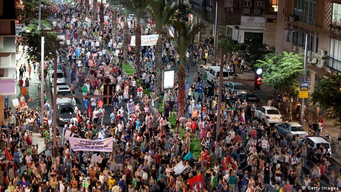 Demonstrators march through the streets to protest against rising housing costs on July 14, 2012 in Tel Aviv, Israel.