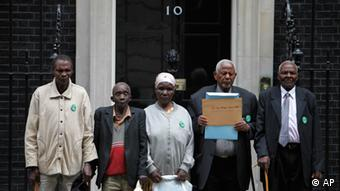 Kenyans, from left to right, Ndiku Mutua, Paulo Nzili, Jane Muthoni Mara, Gitu Wa Kahengeri and Wambugu Wa Nyingi, pose for the photographers in front of British Prime Minister Gordon Brown's official residence at 10 Downing street in central London, prior handing their petition, Wednesday, June 24, 2009. The people in their 70's and 80's travelled to London from their rural villages for the first time to hand the petition and claim their legal rights against the then British colonial regime. According to the petition, during the struggle for Kenyan independence in the 1950's and 1960's they were arrested, detained in detention camps accused of being members of the Mau Mau movement and tortured. (ddp images/AP Photo/Lefteris Pitarakis)