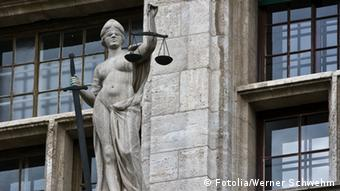 A statue of Justitia, goddess of Justice © Werner Schwehm #10382551