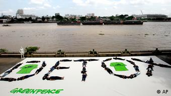 "Forty Greenpeace activists form a human banner with a message of ""Detox"" in Bangkok on Thursday, July 14, 2011. (Photo: Sakchai Lalit)"