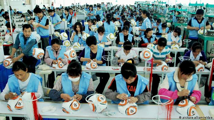 Workers work on the production line making the 2010 FIFA World Cup South Africa official ball at Jiujiang Simaibo Sports Equipment Corporation Ltd. on May 7, 2010 in Jiujiang, Jiangxi Province of China. Photo: Hu Guolin/Chinafotopress