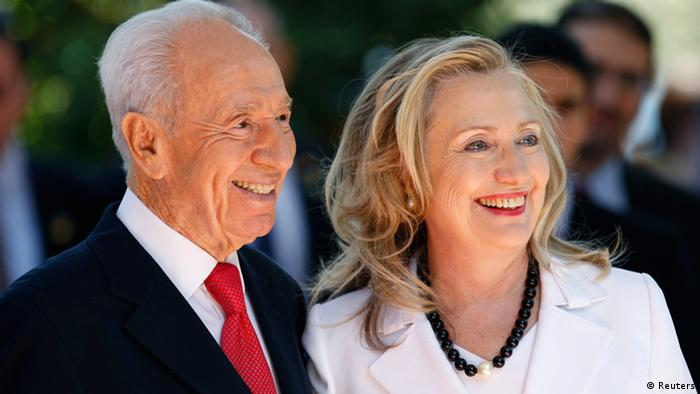 Israeli President Shimon Peres stands with US Secretary of State Hillary Clinton before their meeting in Jerusalem