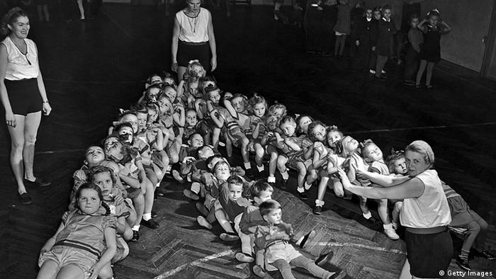 Four-year-olds learn simple exercises in a Sokol gymnasium in Czechoslovakia in the 1930's