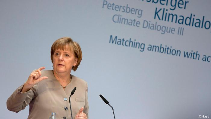 German Chancellor Angela Merkel gestures during her speech at the third Petersberg Climate Dialogue in Berlin, Germany, Monday, July 16, 2012. Politicians and environmental experts from over 30 countries meet to prepare the UN climate conference in Doha later this year. (Foto:Gero Breloer/AP/dapd)