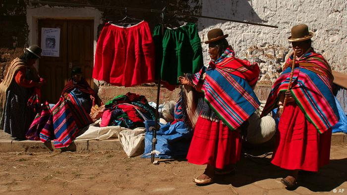 Bolivian Aymara women shop in the streets