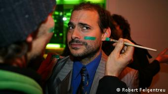 "A picture of Mike Bonanno from the activist network ""The Yes Men"" as he gets his green badge of honor. Photo: Robert Felgentreu"