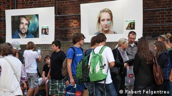 "Passersby in a busy Hamburg shopping area look at ""The Green Path"" exhibition. Photo: Robert Felgentreu"