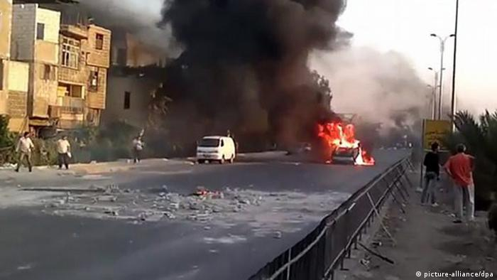 A video grab made from a handout video made available by Shaam News Network on 16 July 2012, shows a vehicle on fire allegedly on the international road at Naher Aisha area of Damascus, Syria. According to the Syrian Arab News Agency