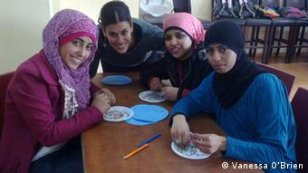 Israeli Arab national service volunteers in Haifa, doing beading work
