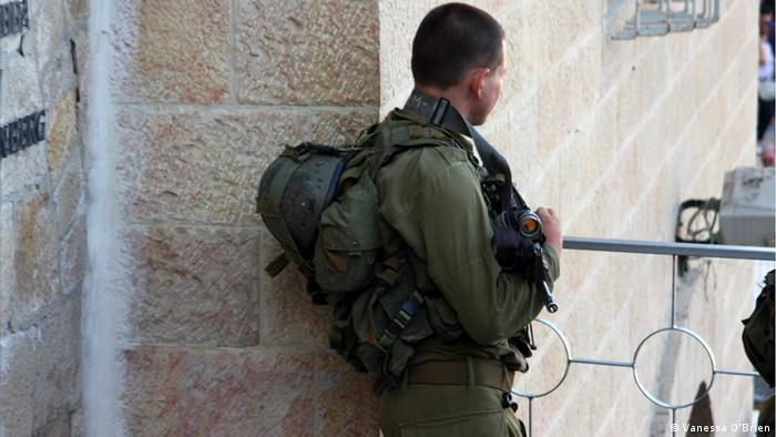 An Israeli soldier stands guard in Jerusalem's Old City, Israel