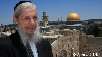 Rabbi Shimon Hurowitz stands on the balcony of the Aish HaTorah building