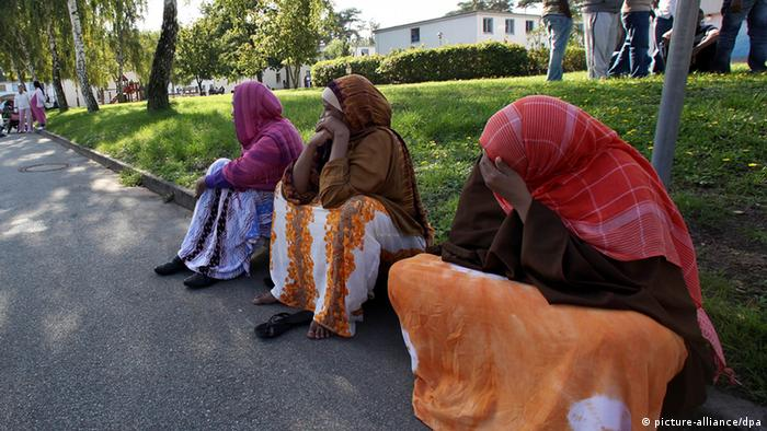 Asylum seekers sitting on the street