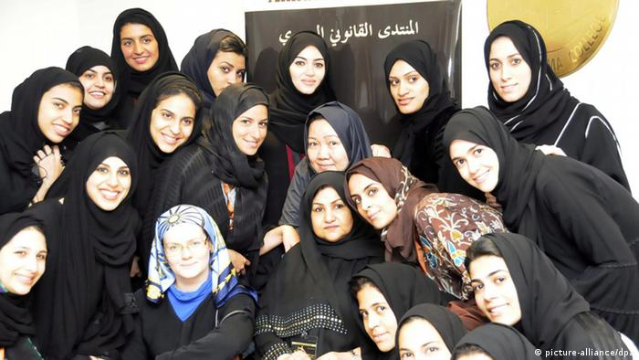epa02738662 A photograph made available on 17 May, 2011 shows 15 Saudi women who are going to be the first Saudi women lawyers, around their professors. Dar Al-Hekma college launched a law forum under the title 'First steps for Saudi women lawyers' in Jeddah, Saudi Arabia on 16 May 2011. The forum ,first of its kind, trains 15 Saudi female undergraduate lawyers in a skill they need when they enter the job market. The forum discusses Saudi law, environmental law and human rights to empower the contribution of Saudi women to the field of law toward involving Saudi women in the community issues. EPA/Dar Al-Hekma media offic/HANDOUT BEST QUALITY AVAILABLE HANDOUT EDITORIAL USE ONLY/NO SALES