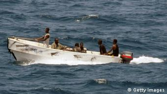 Pirates leave the merchant vessel MV Faina for the Somalia shore (Photo: Jason R. Zalasky/U.S. Navy via Getty Images)
