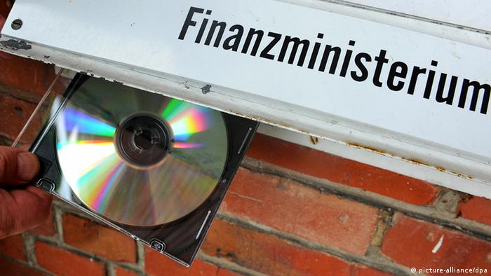 Photo of CD next to a computer from Germany's finance ministry.