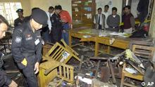 Security personnel inspect the courthouse after a bomb exploded in Gaizipur, about 32 kilometers (20 miles) north of capital Dhaka, Bangladesh, Tuesday, Nov. 29, 2005. A series of bombs exploded in two Bangladesh cities Tuesday, killing at least six people including two alleged bombers and two policemen, and injuring at least 66, in what appeared to be the latest in a string of attacks by militant Muslims intent on imposing harsh Islamic law in the country. (AP Photo/Pavel Rahman)
