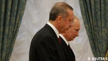 Russian President Vladimir Putin (R) and Turkish Prime Minister Tayyip Erdogan walk together after a news conference in Moscow's Kremlin July 18, 2012. REUTERS/Sergei Karpukhin (RUSSIA - Tags: POLITICS)