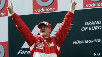 Germany's driver Michael Schumacher celebrates after winning the Formula One Grand Prix of Europe at the Nuerburgring circuit