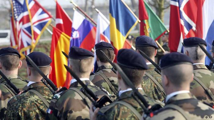 Soldiers participate in a military ceremony at a NATO summit (photo: AP/Christian Lutz)
